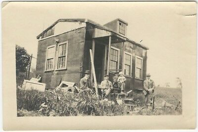 Four Men & Baby Sit by Partly Disassembled Building 1910s Architecture Snapshot