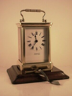 Antique brass carriage clock C 1900. Key. Originally sold by Harrods of London.