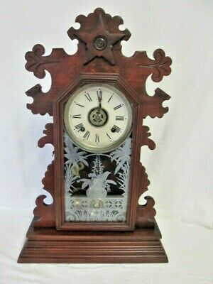 A Mahogany Ansonia Gingerbread Alarm & Chime Mantel/Shelf Clock