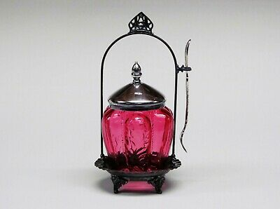 A beautiful Victorian cranberry glass jar &  silver plate pickle caster .