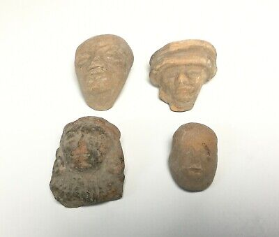 Pre-columbian Teotihuacan heads pendant on clay.