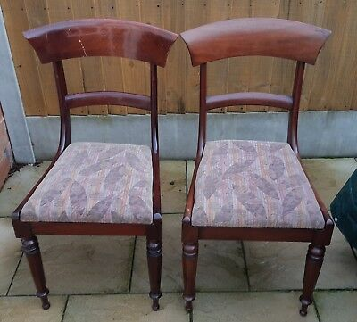 Two Wood Vintage mahogany chairs with turned legs and original cushioning