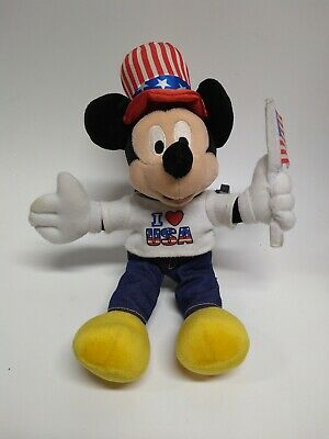 I love USA Mickey mouse plush. With flag. Pre owned. Shipped w/ USPS first class