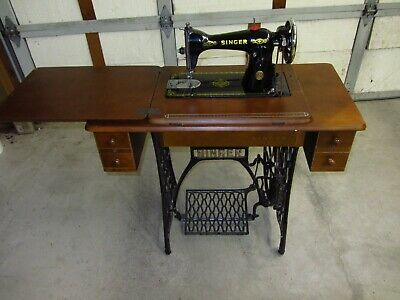 Singer, Model 15, treadle sewing machine.  Later version, in wood cabinet.