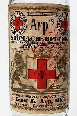 1907 Paper Label Arp's Stomach Bitters In Fancy Bulbous Neck Round Clear Bottle