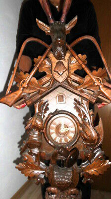 very large cuckoo clock all in solid Wood, also the horns in wood 90 cm