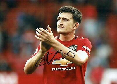 Harry MAGUIRE Signed Autograph 16x12 Photo 5 AFTAL COA Manchester United Man Utd