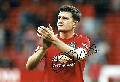 Harry MAGUIRE Signed Autograph 12x8 Photo 5 AFTAL COA Manchester United Man Utd