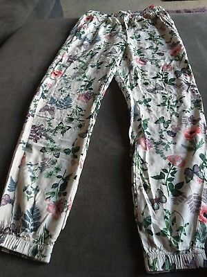 H & M Girls White Flower Pattern Trousers Size 9-10 Years Good Condition