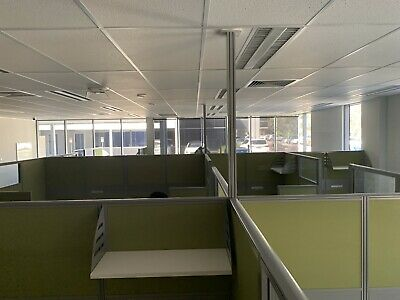 Over 30 office desks with partitions already dismanteled. Must be sold