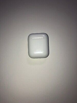 Apple AirPods With Charging Case (look at photos)