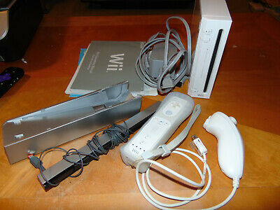 Nintendo Wii White Console (NTSC) comes with one Wii mote Game Cube Compatible
