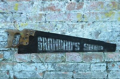 old antique vintage saw  metal plasma cutout grandad's shed , industrial sign