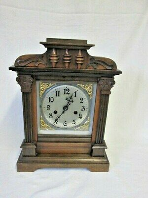 A Late 19th Early 20th Century Walnut Chiming Mantel Clock