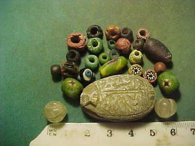 25 + ancient beads circa 1000 BC-1700 AD + Egyptian scarab amulet .