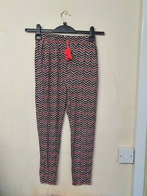 girls multi coloured zigzag patterned tapered trousers  age 11 yrs