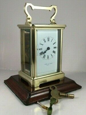 Antique brass carriage clock & key. Restored and serviced January 2019.