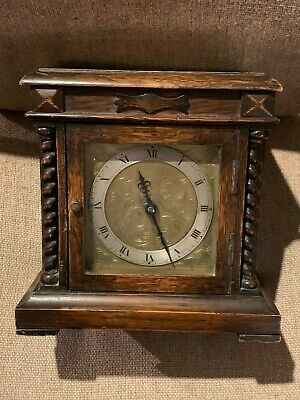 Old / Antique clock . Oak case , Brass & Silvered dial .