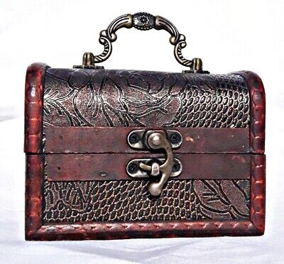 An embossed antique treasure chest that can be used to store precious jewelry
