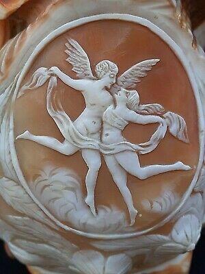 Vintage carved 14 cm conch shell depicting Daedalus & Icarus : erotica erotic