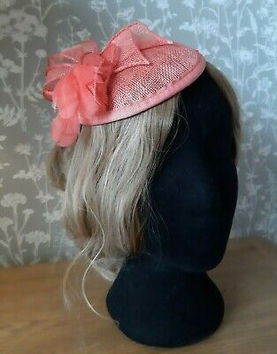 Coral / salmon pink disc fascinator with comb and elastic, for wedding, races