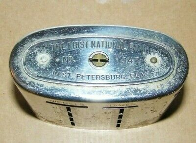 vintage tin steel penny bank-First National Bank St. Petersburg,Fla Traveling te