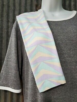 LuLaRoe Tween Leggings. Pastel purple/blue/yellow. Hanger imprint on waistband