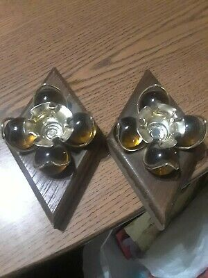 Vintage candlestick holders with handblowwn glass balls on diamond shaped wood.