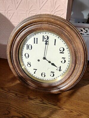 Oak Cased Circular German Made Wall Clock By Franz Hermle.