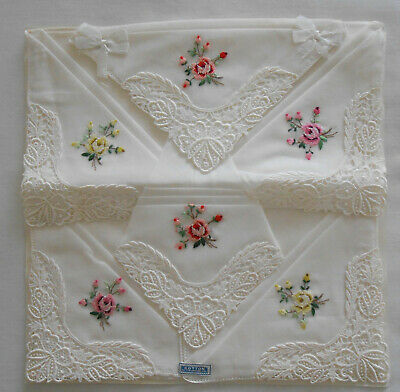 6 vintage Swiss embroidered hankies with lace corners, on original backing