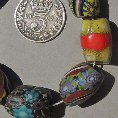 a variety of 11 old antique venetian oval millefiori african trade beads #4846