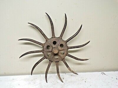 Old cast iron IHC Rotary Hoe Spiked Wheel for garden deco