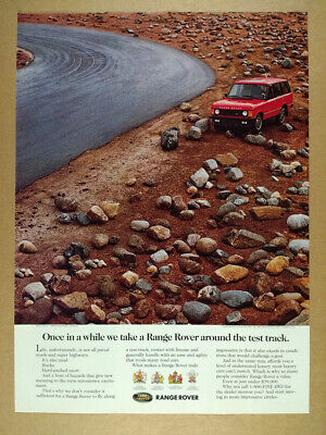 1992 Range Rover Classic driving over rocks photo vintage print Ad