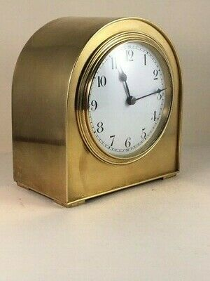 "Small solid brass ""humpbacked"" clock with French movement. Fully restored"