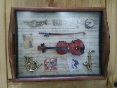 A Collection Of Miniature Musical Instruments Mounted In A Frame ,
