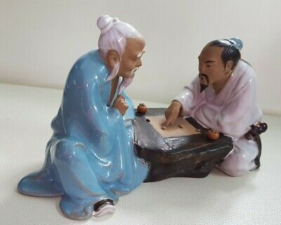 Large Chinese Shiwan 'mud man' figurine. Pair of men playing a board game.