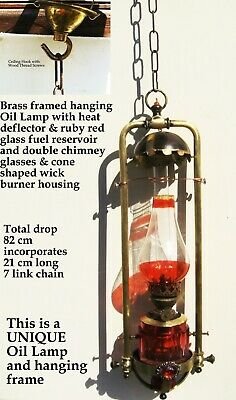 Brass frame hanging oil lamp with red glass fuel reservoir & shade decoration