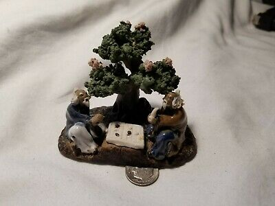 Chinese Mud Man Duo playing a board game w/Bonsai tree. Painted and glazed.