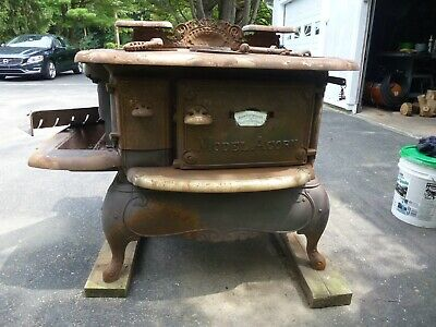 antique Acorn cast iron coal stove needing restoration - Rathbone,Sard & Co.