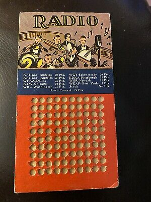 Radio Gambling punchboard. NEVER used with sealed KEY in back.