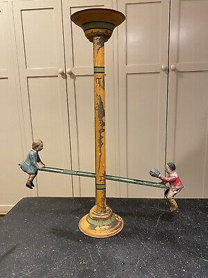 Antique Teeter-totter Handpainted Tin Toy
