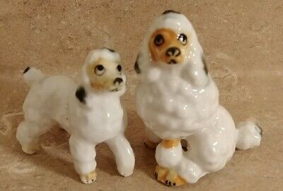 2- Hagen Renaker ? Poodles Small Ceramic Dog Figures.