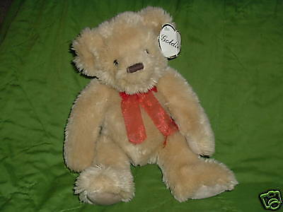 Laura Secord Teddy Bear Goldie with red ribbon