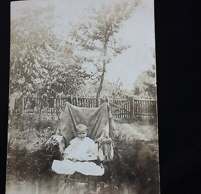 VINTAGE RPPC BABY IN ROCKING CHAIR PICKET FENCE