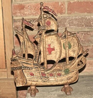 Doorstop sailing ship old vintage cast iron lamp base Maltese cross sail rustic