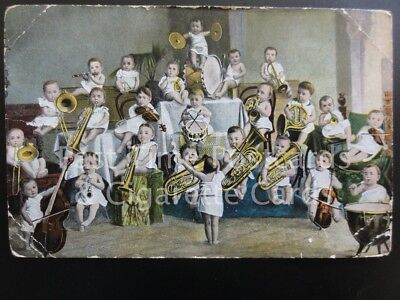 Baby Orchestra c1904 showing 24 babies as an orchestra