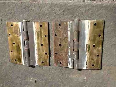 One pair of large brass hinges