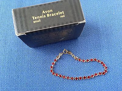 VINTAGE NEW IN BOX AVON SMALL GOLD TONE AND RED STONE TENNIS BRACELET