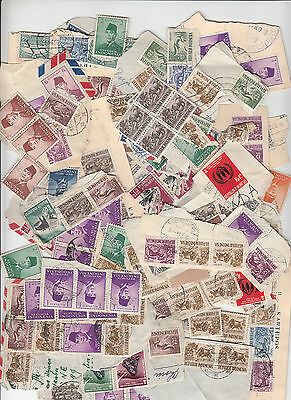 Stamps Indonesia 130 grams many still on piece, could be anything here postmarks