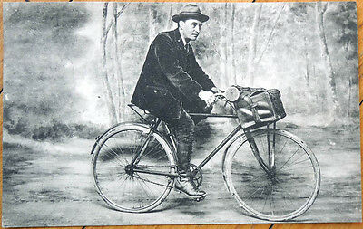 1925 French Postcard: Man Riding Bicycle in the Woods / Painted Backdrop